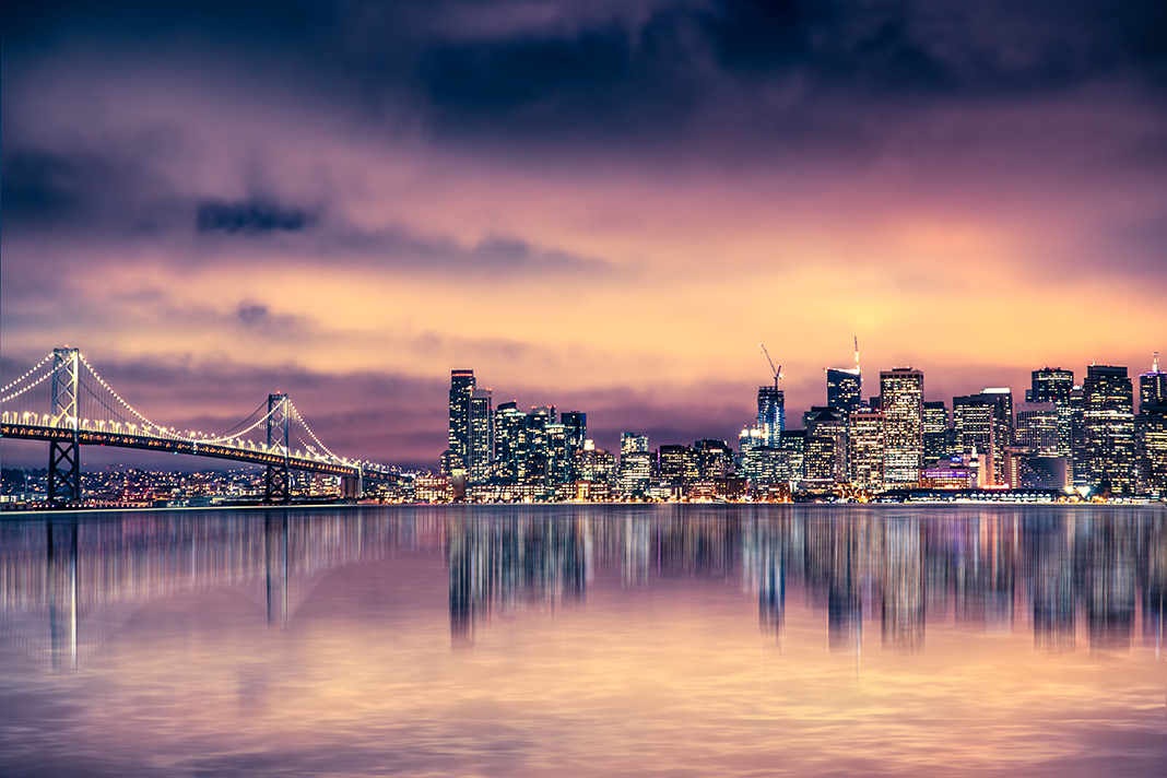 San Francisco California skyline with lights and bay under color